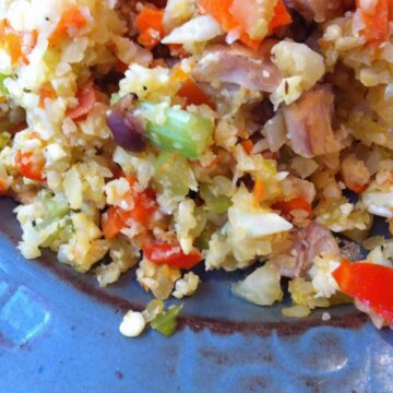 cauliflower fried rice with chicken on plate