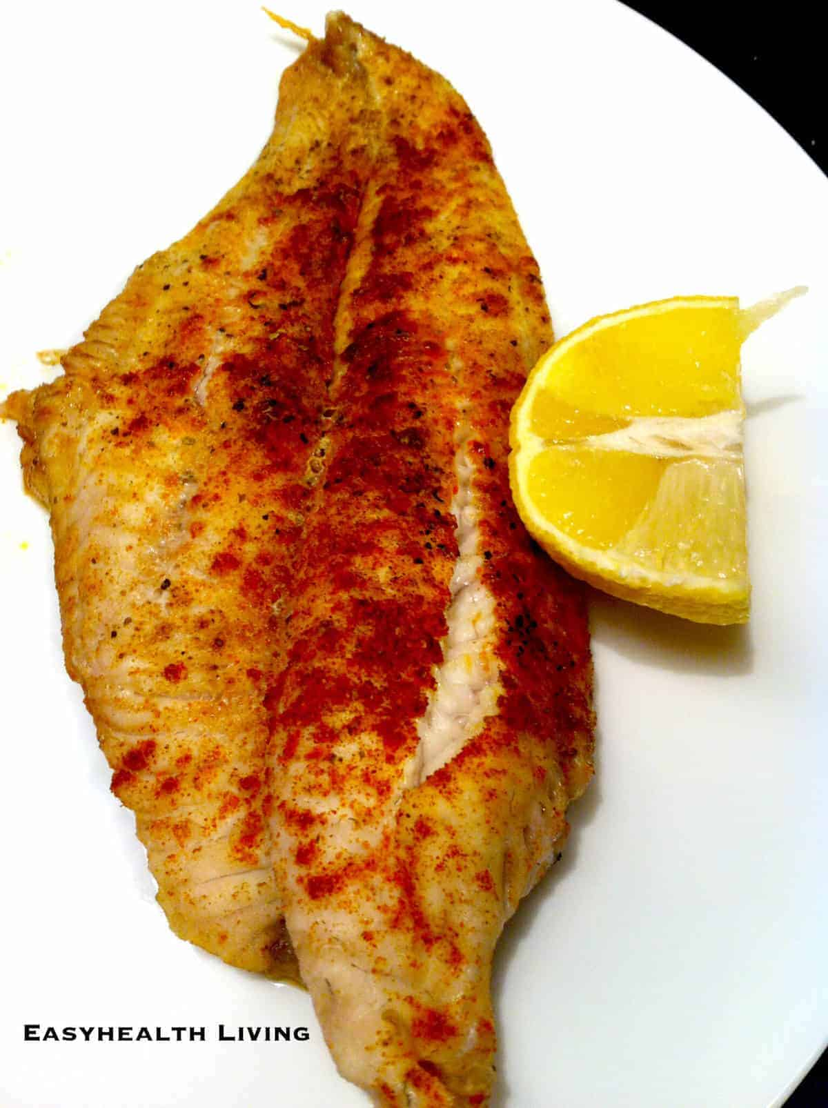 Low carb baked fish uses tasty seasonings and herbs to make the perfect healthy meal.  Chooses a low sodium seasoning if you are watching your salt intake. #bakedfish #lowcarb