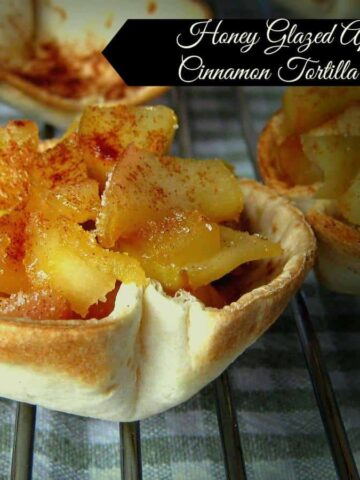 A tortilla cup filled with glazed apples