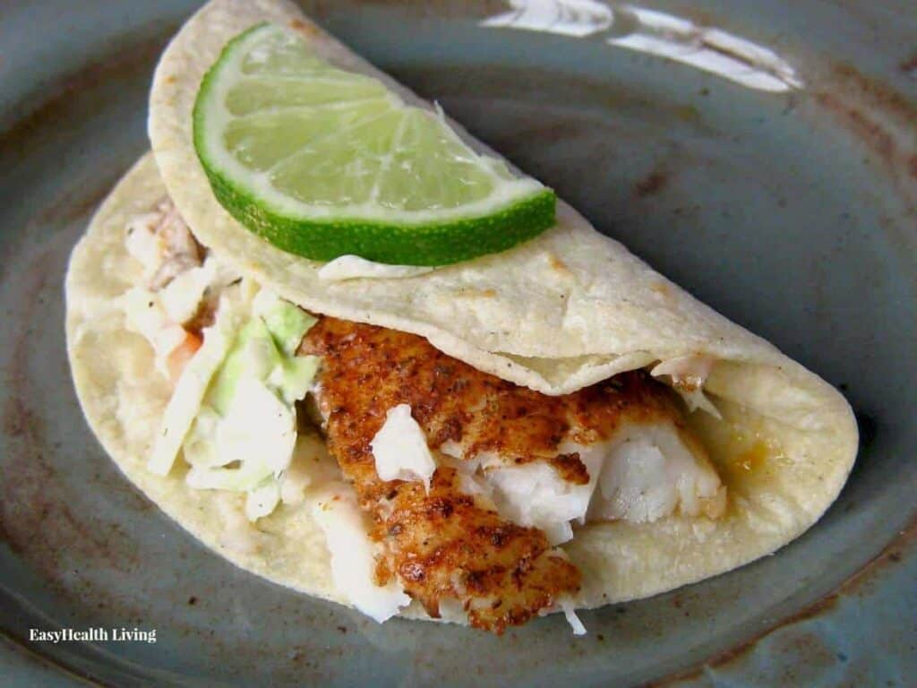 Seasoned fish tucked in a crunchy tortilla with lime flavored slaw