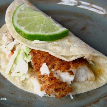 fish taco with slice of lime on top