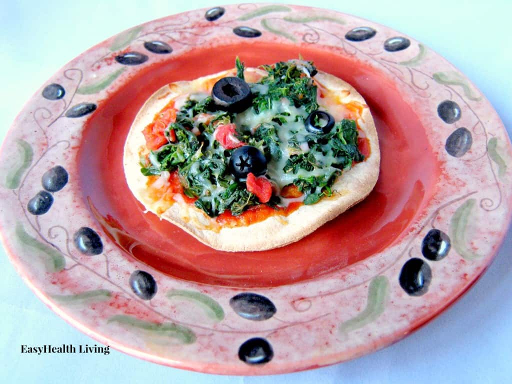 Crispy Tortilla topped with Roasted Cherry Tomatoes, Olives and Spinach