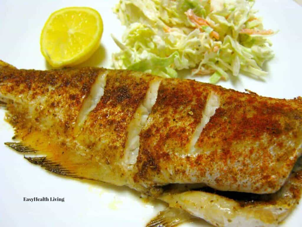 Whole baked catfish with cajun seasoning