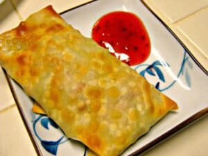 Crispy Baked Egg Rolls on plate with sauce