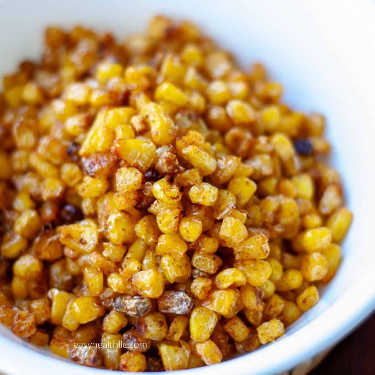 yellow roasted sweet corn in white bowl