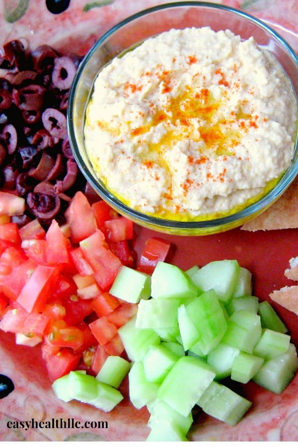 hummus olives cucumbers on platter