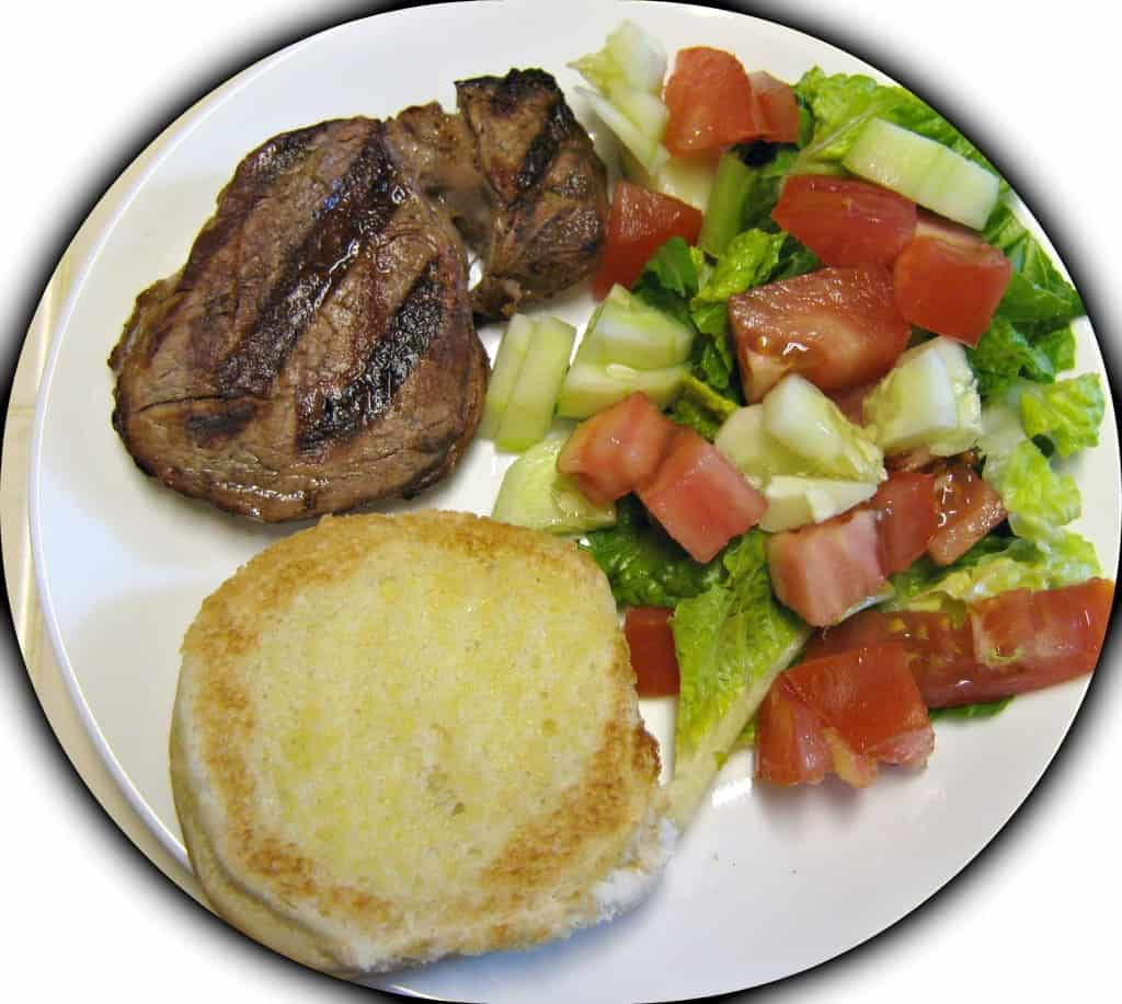 Steak = 0, Salad = 5gm, 1/2 hamburger bun = 15gm