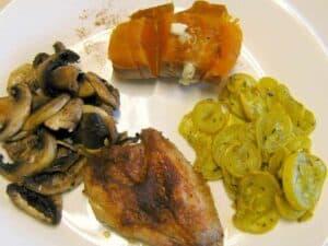 Dry Rub BBQ Chicken, ½ cup baked Sweet Potato (15gm carb), Herb Roasted Squash (3 gm carb), Easy Mushrooms (2gm carb)