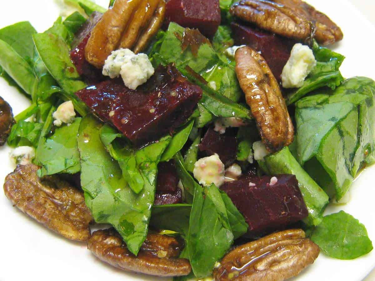 A roasted beet salad with gorgonzola and candied pecans! Step by step easy instructions show you how to make this salad-perfect for family meals or company.