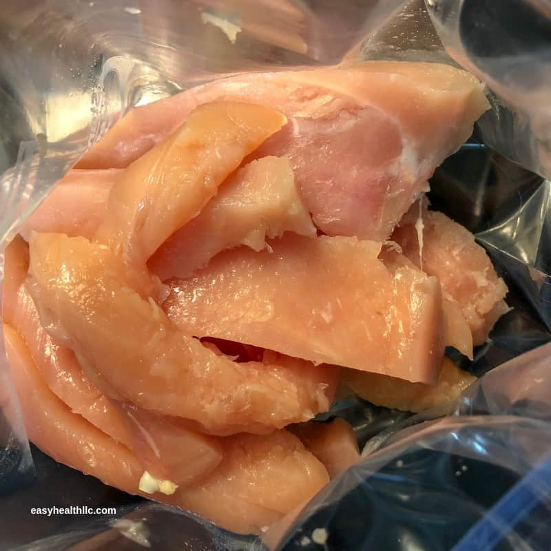 raw chicken tenders in baggie