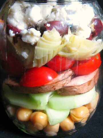 chick peas, cucumbers,tomatoes layered in jar