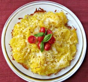 spaghetti squash and cheese on plate with cherry tomatoes