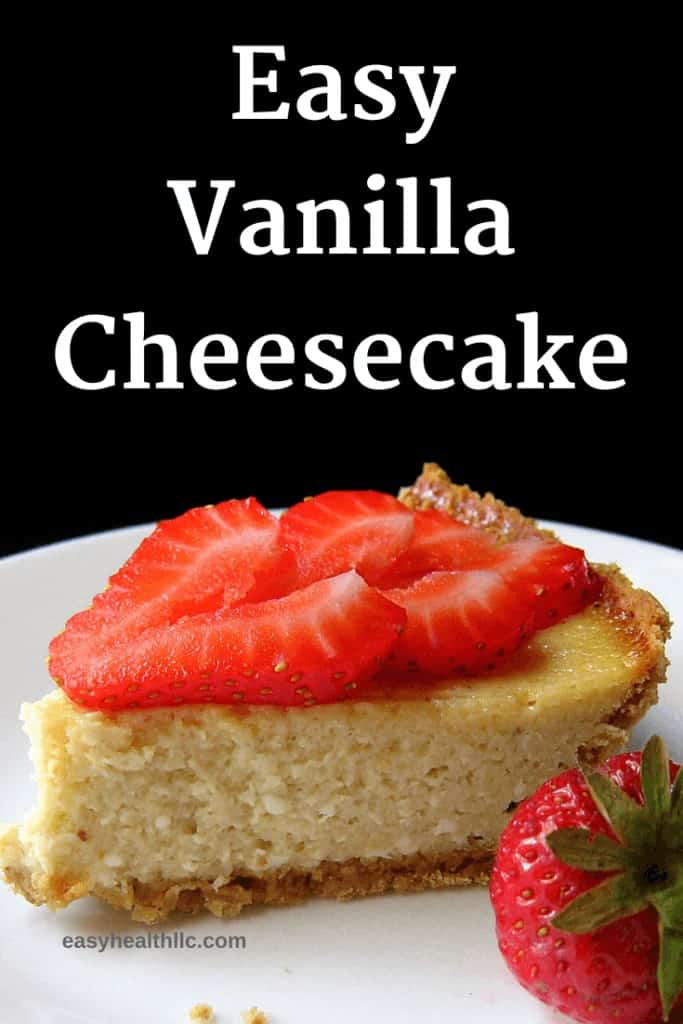 cheese cake with sliced strawberry on top on white plate