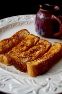 Eggnog French Toast Sticks on white plate