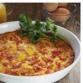 Sweet Potato Tot Breakfast Casserole in white bowl with parsley