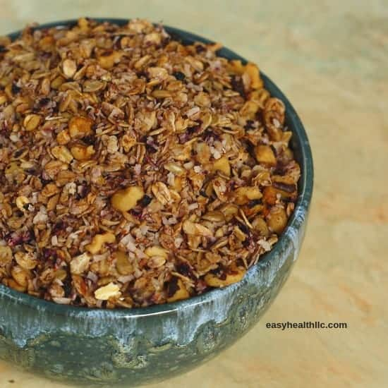 blueberry granola in green bowl