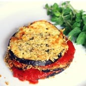 lean eating eggplant parmesan on white plate