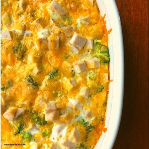 turkey broccoli casserole in white casserole dish