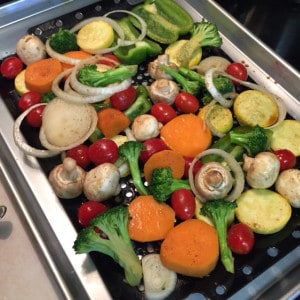 Veggies on grate ready to be grilled.