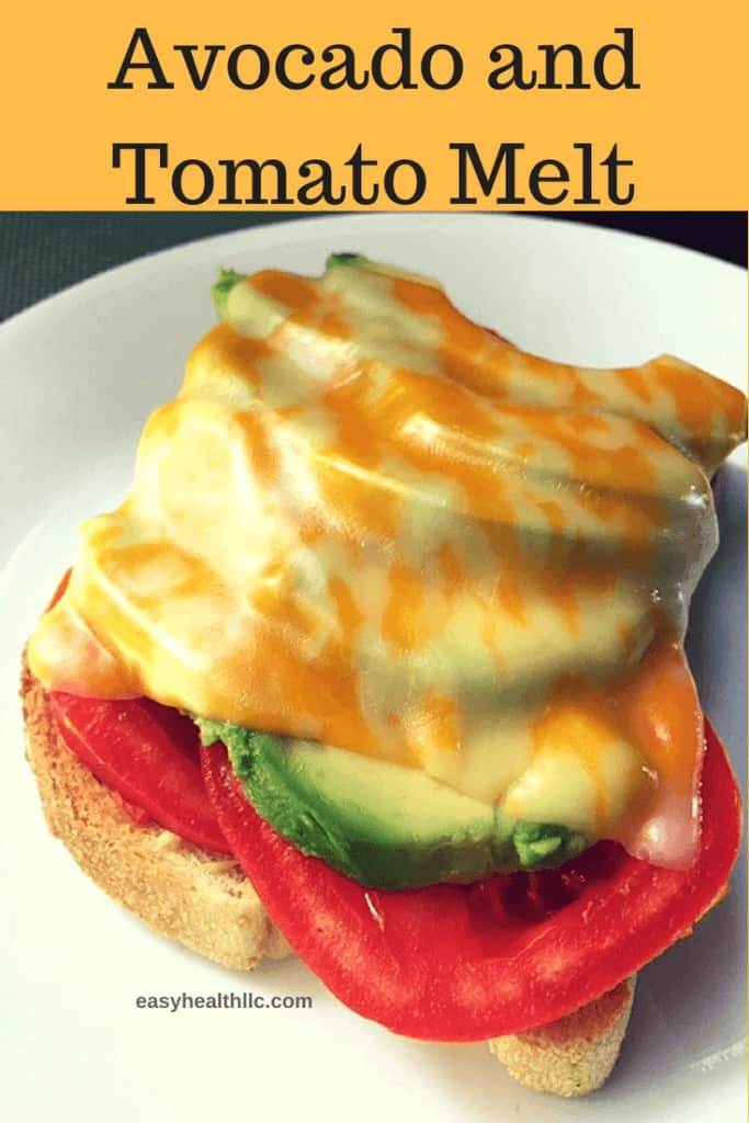 toast with tomato slice avocado slice and melted cheese