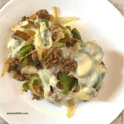 philly cheesesteak mixture on white plate