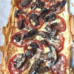 Tomato Mushroom Pizza on parchment paper