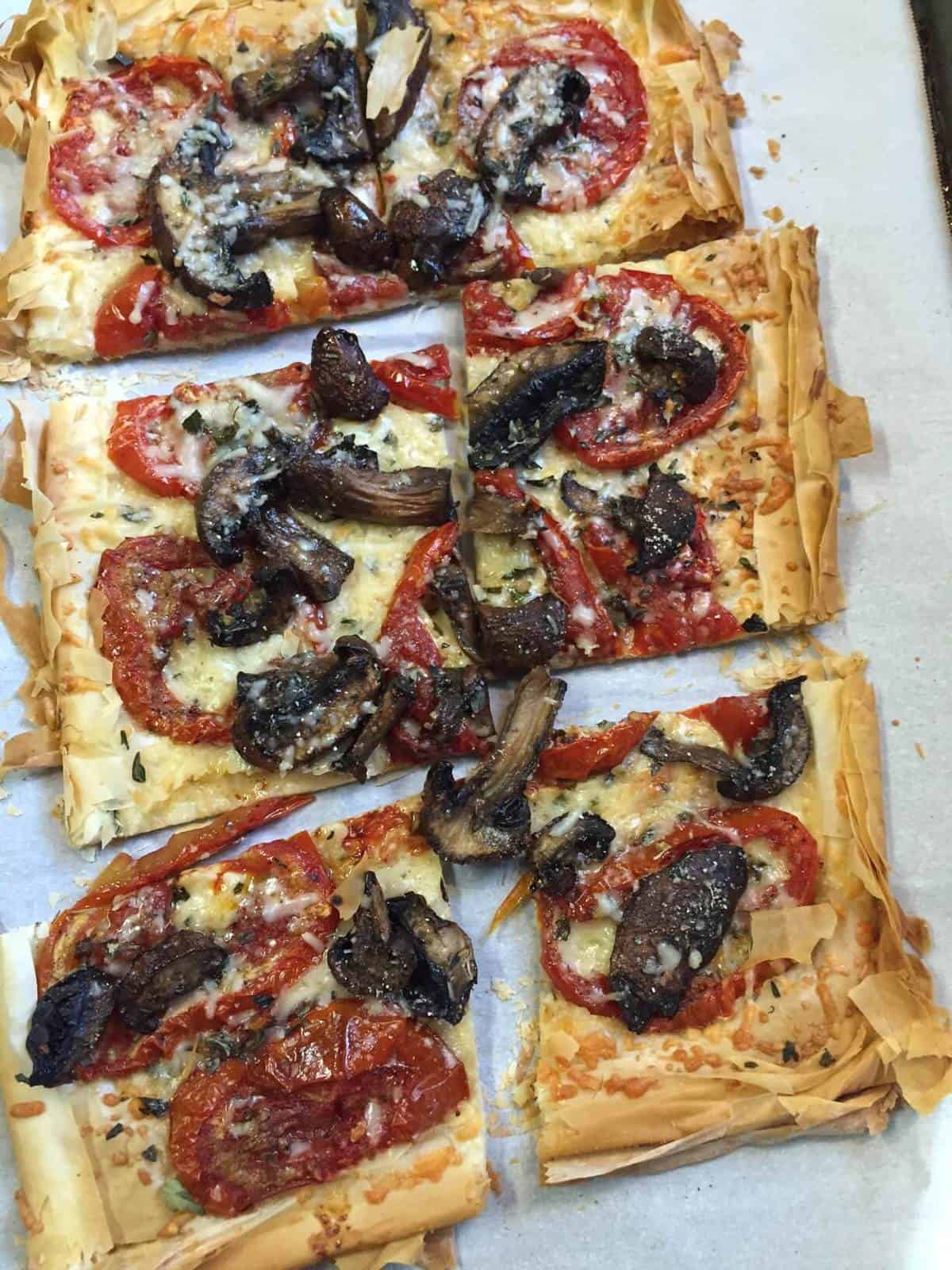 A low carb pizza featuring roasted mushrooms and tomatoes with a phyllo crust!  A delicious and diabetes friendly option for pizza night.