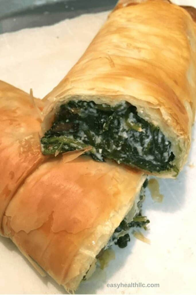 spinach ricotta roll on white plate