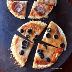 Cheesy Crispy Low Carb Pizzas on cutting board