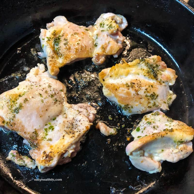 chicken sautéing in skillet
