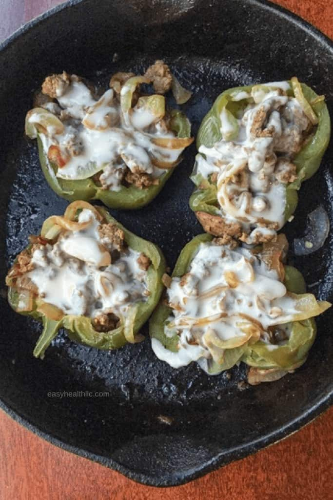 philly cheesesteak stuffed peppers in black skillet