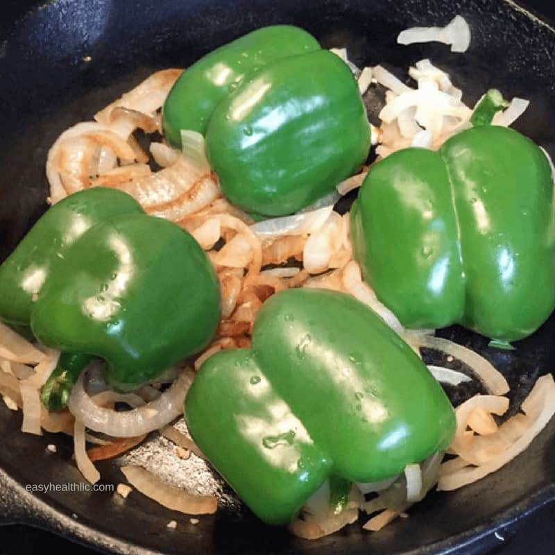sautéed onions with green bell pepper halves on top