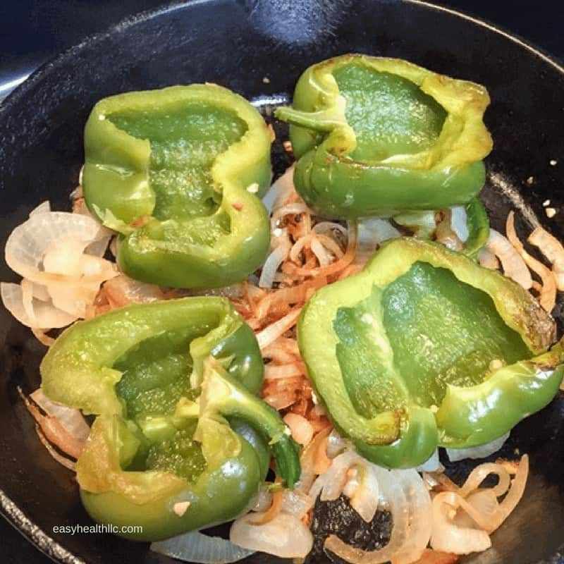 cooked peppers with green bell pepper halves on top