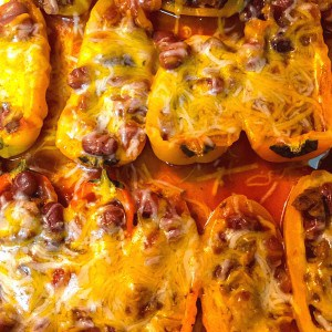peppers filled with chili and cheese on metal pan