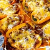 peppers stuffed with chili and cheese on metal pan