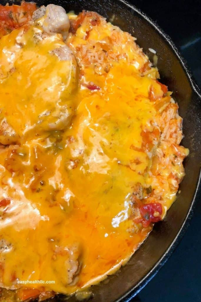 mexican rice and pork chops in skillet