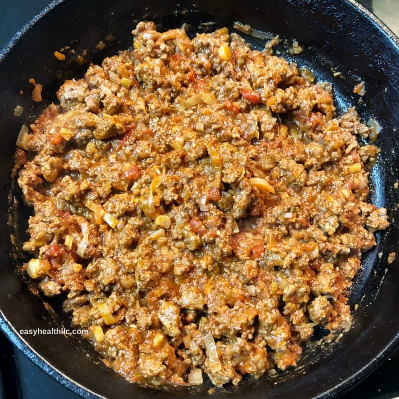 ground beef, tomatoes and onions in skillet