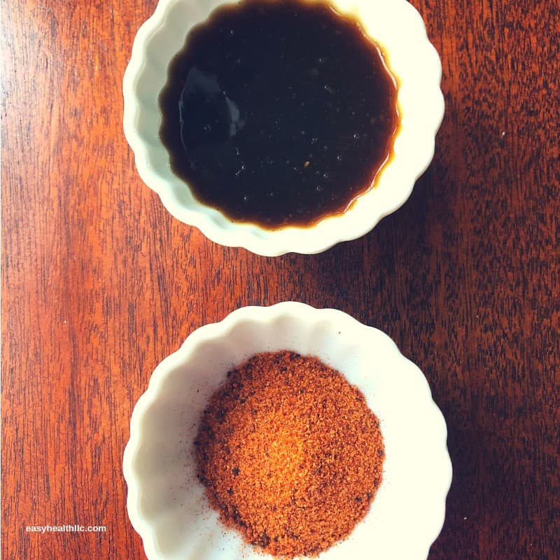 rotisserie seasoning and korean bbq sauce in small white bowls