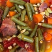 ham chunk with carrots, tomatoes and green beans in soup