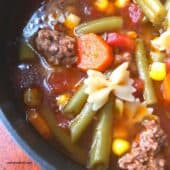 soup with carrots, green beans, bowtie pasta and ground beef
