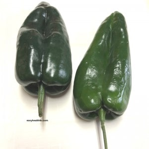 2 poblano peppers on table