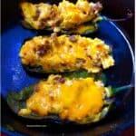 egg stuffed poblanos in skillet