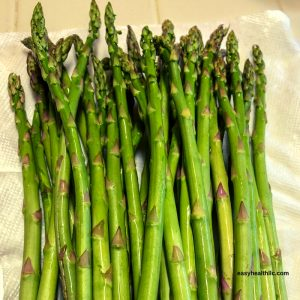 fresh asparagus on parchment paper