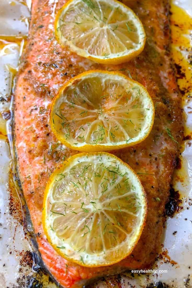 roasted salmon on pan with lemon slices
