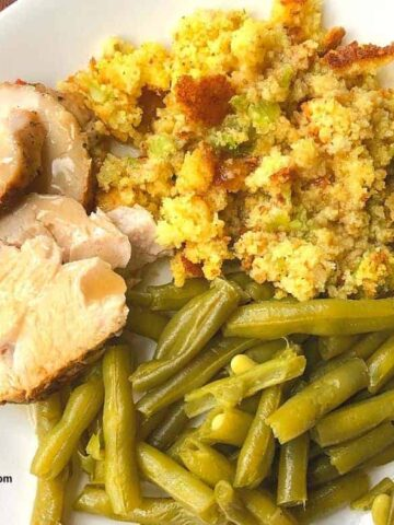 plate of cornbread dressing and turkey