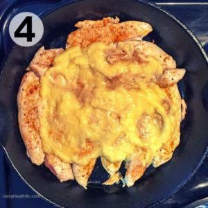 chicken and sauce in iron skillet