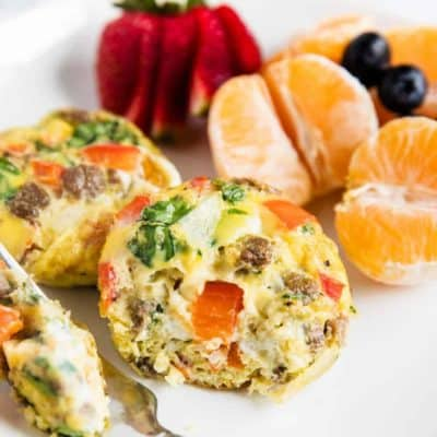 egg muffins with fruit on white plate
