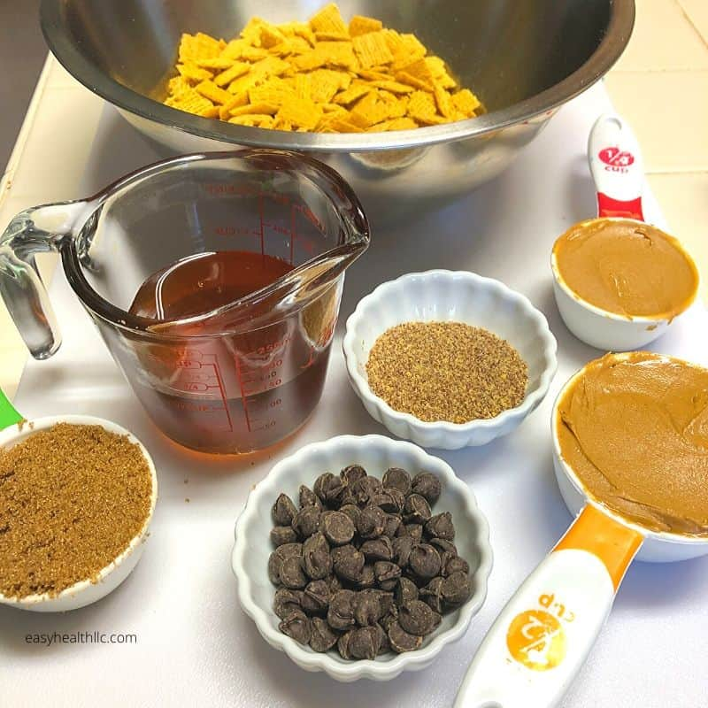measuring cups filled with peanut butter chew ingredients