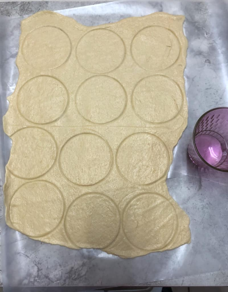 crescent roll dough with circles cut