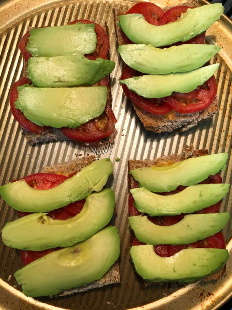 sliced avocado and tomatoes on toast